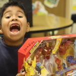 A student screams in excitement over his new present.